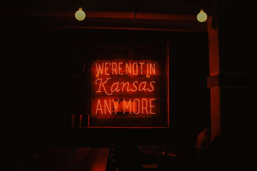 we're not in Kansas anymore red neon signage turned on
